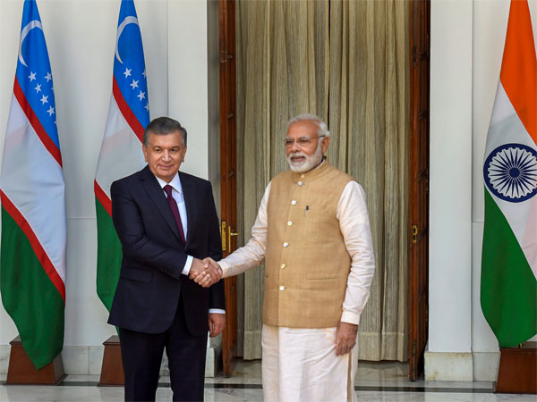 Prime Minister Narendra Modi shakes hands with Uzbekistans President Shavkat Mirziyoyev at Hyderabad House, in New Delhi