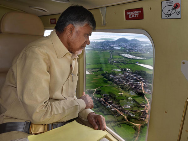 Andhra Pradesh Chief Minister N Chandrababu Naidu take a stock of areas affected by cyclone Titli through an aerial survey, in Srikakulam