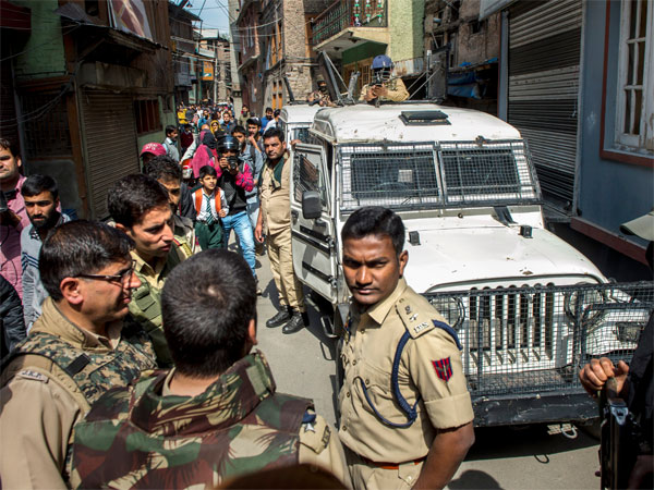 Police arrive at the spot where two National Conference workers were allegedly shot dead by militants, three days ahead of the first phase of elections for urban local bodies, at Karfali Mohalla in Down Town, Srinagar