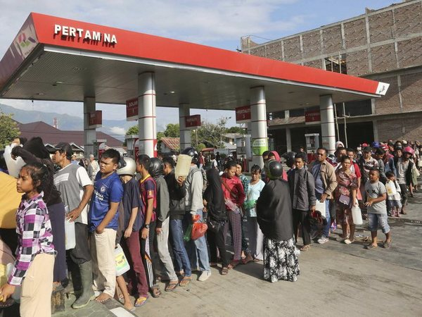 In this Sunday, Sept. 30, 2018, file photo, people queue for gasoline following a massive earthquake and tsunami in Palu, Central Sulawesi, Indonesia. AP/PTI photo