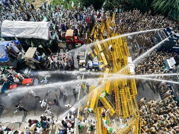Police use water cannons to disperse farmers protesting at Delhi-UP border during Kisan Kranti Padyatra in New Delhi on Tuesday. PTI photo