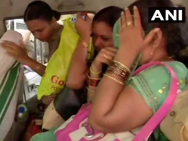 Sabarimala: Two women stopped by protesters from trekking towards Shrine, forced to return