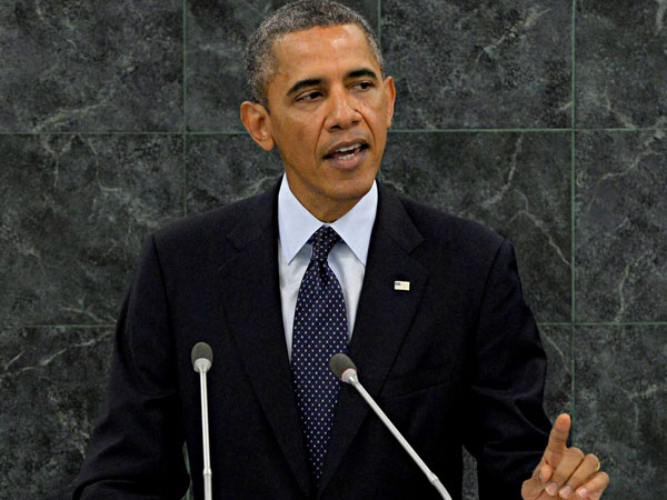Obama takes a dig at Trump for