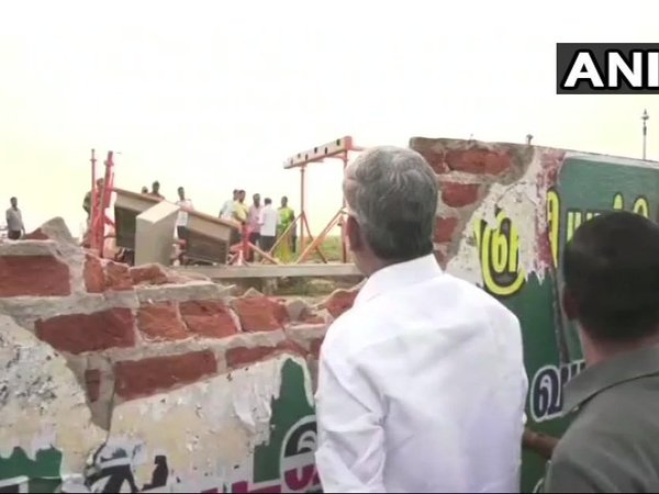 Air India flight hits compound wall at Trichy Airport. Courtesy: ANI news