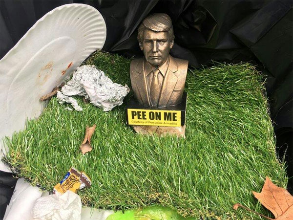 Donald Trump busts appear in Brooklyn with tag 'pee on me'!