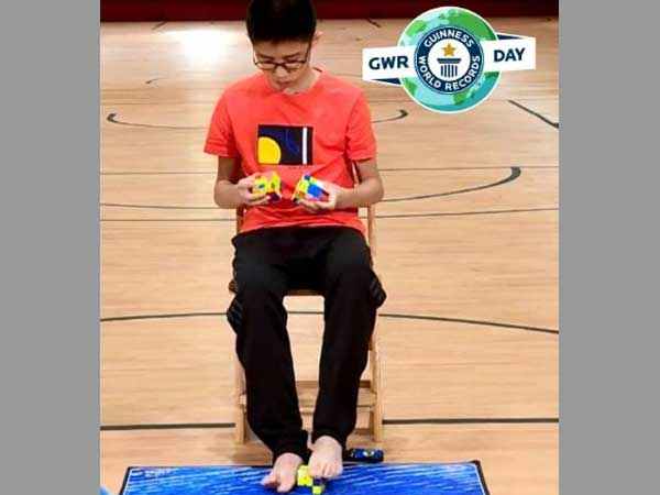 Chinese teenager solves three Rubik's cubes with hands and feet at same time