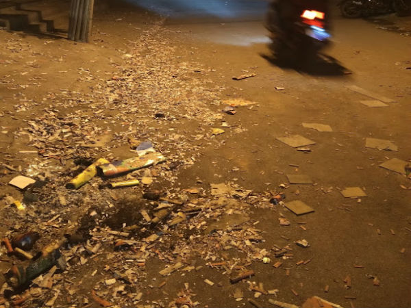 Firecracker waste layers roads, dust chokes lungs