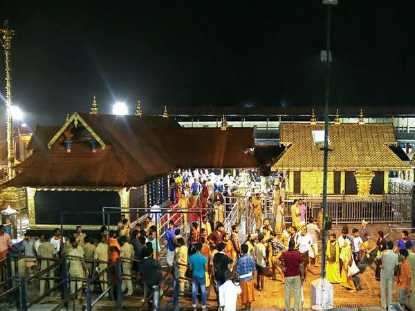 Devotees pay obeisance Lord Ayyappa temple in Sabarimala