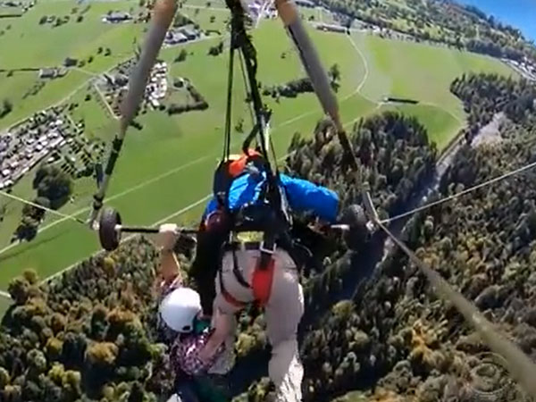 Tourist clings on to for life on hang-glider in the air; says later 'I will go again'