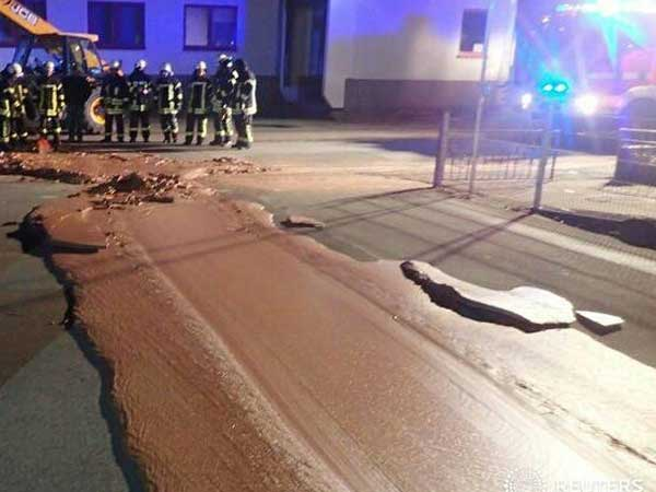 Yummy menace! Chocolate overflows from factory storage onto street in Germany town