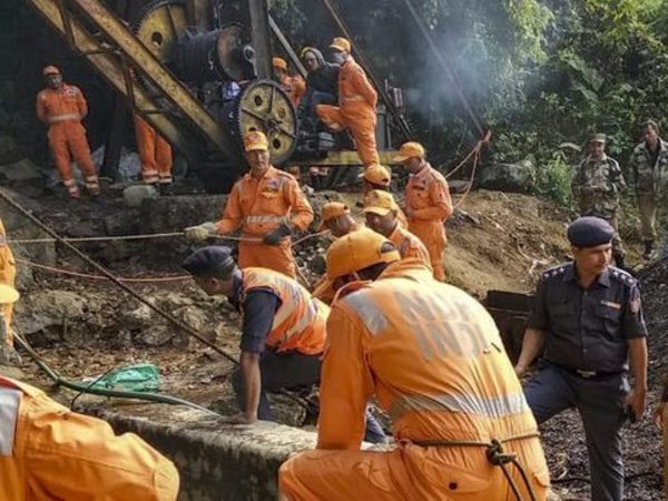 NDRF personnel conduct rescue of the thirteen people who remain trapped in a flooded illegal mine, in East Jaintia hills, Monday, Dec. 17, 2018. (PTI Photo)