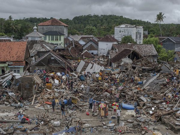 People inspect the damaged at a tsunami-ravaged village in Sumur, Indonesia (PTI photo)