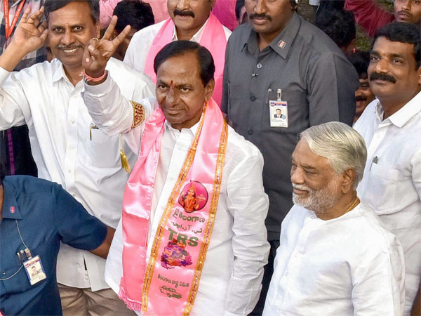 Telangana Rashtra Samithi (TRS) chief K Chandrasekhar Rao display a victory sign after his party won the state Assembly elections, at Telangana Bhavan in Hyderabad