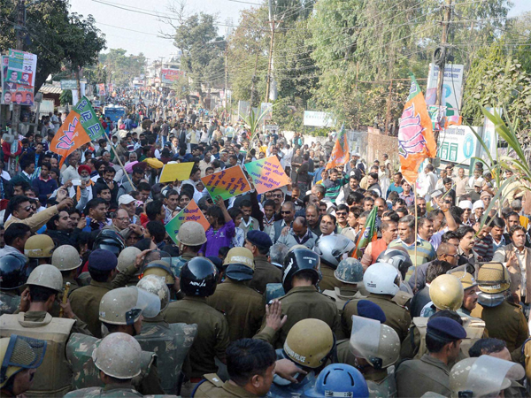 BJP Kisan Morcha workers march during a protest rally