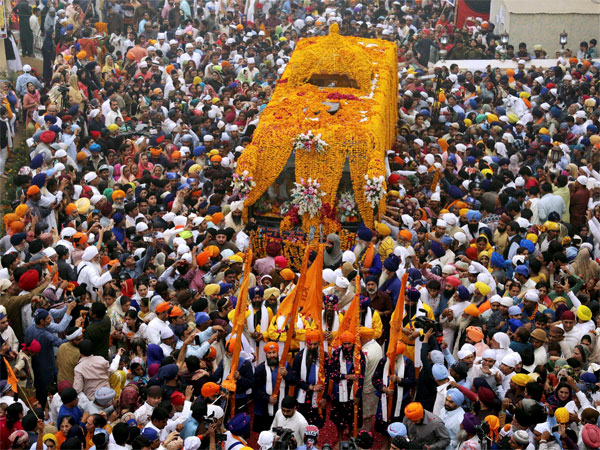 Sikh pilgrims attend a religious festival to celebrate the 549th birth anniversary of their spiritual leader Baba Guru Nanak, at Nankana Sahib near Lahore, Pakistan
