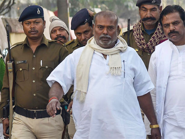 Suspended RJD MLA Raj Ballabh Yadav leaves the court after being sentenced to life imprisonment for raping a minor girl in 2006, in Patna