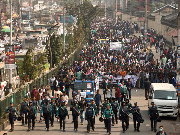 Supporters of Bangladesh Awami League take out an election rally ahead of the general election in Dhaka, Bangladesh