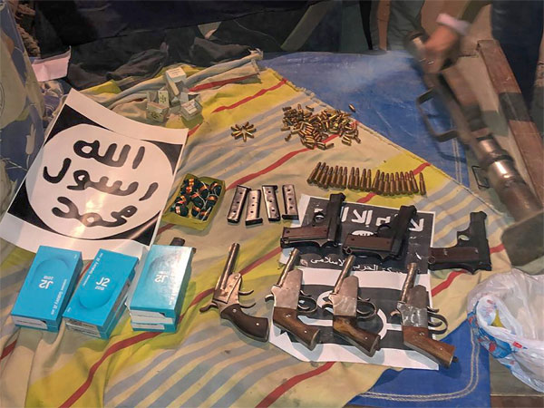 Several weapons and a cache of ammunition which were recovered by the National Investigation Agency