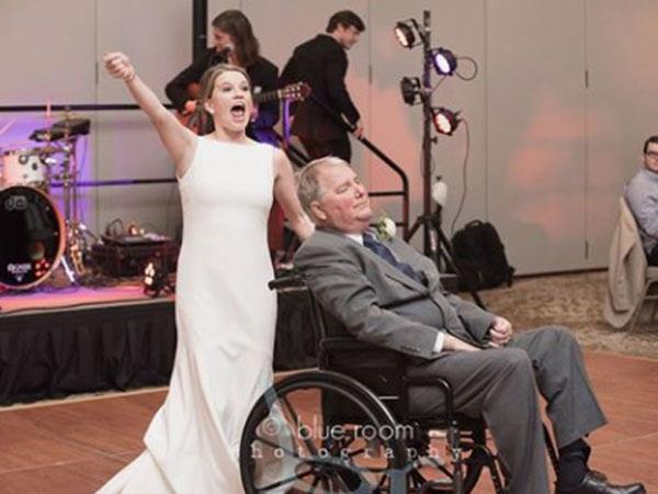 Bride dances on wedding with wheelchair-bound father
