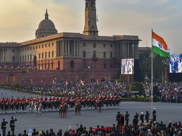 The national flag is unfurled as President Ram Nath Kovind and tri-services chiefs pay their salute during the Beating Retreat ceremony