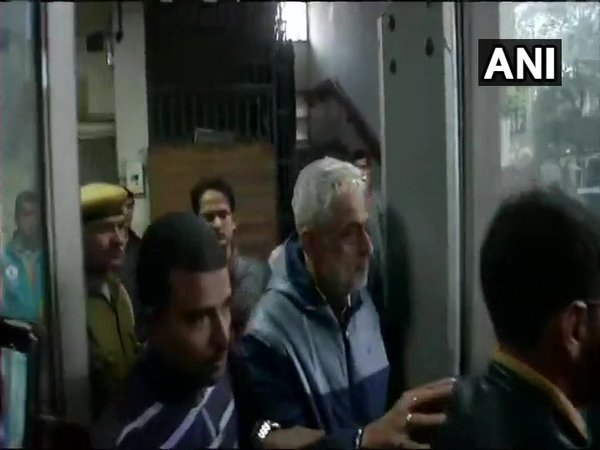 Deepak Talwar (with white hair) being taken to Delhis Patiala House Court. (Image courtesy - ANI/Twitter)