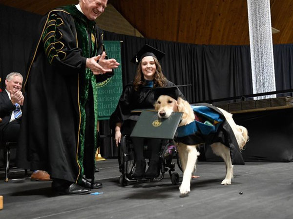 US: Dog awarded with honorary diploma for helping challenged woman graduate