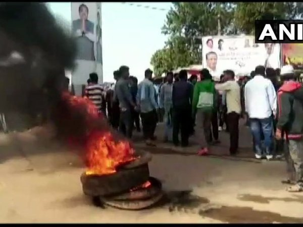 Locals protest after a minor girl gave birth to a child in the hostel of a residential school in Kandhamal. Courtesy: ANI news