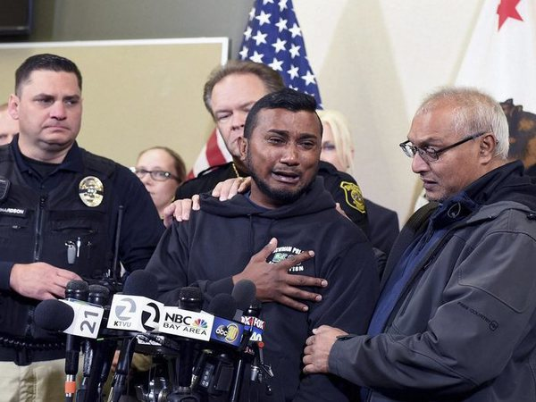 : Reggie Singh, brother of Newman Police officer Ronil Singh is overcome with emotion as he thanks law enforcement after the arrest of suspect Gustavo Perez Arriaga and others Friday, Dec. 28, 2018 during a news conference at the Stanislaus County Sheriffs department in Modesto. PTI file photo