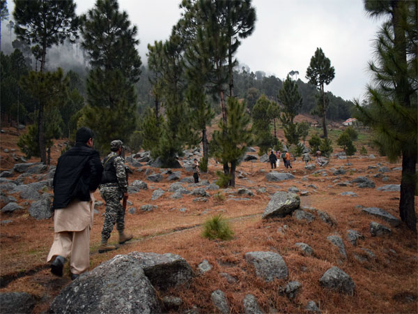 Pakistani reporters and troops visit the site of an Indian airstrike in Jaba, near Balakot, Pakistan, Tuesday, Feb. 26, 2019. Pakistan said India launched an airstrike on its territory early Tuesday that caused no casualties, while India said it targeted a terrorist training camp in a pre-emptive strike that killed a very large number of militants.