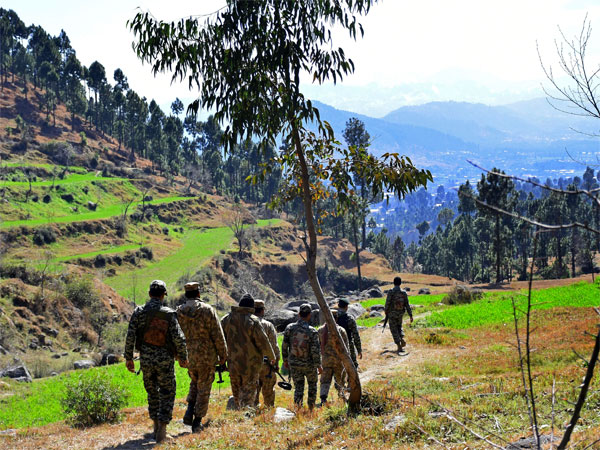 Pakistani soldiers patrol in the area where Indian planes were reportedly shot down by Pakistani forces, after India launched airstrikes yesterday, in Jaba, near Balakot, Pakistan