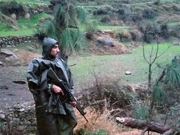 A Pakistani soldier stands guard in the area where Indian jets strike in Jaba near Balakot, in Pakistan