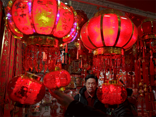 People shop for Lunar New Year decorations at a market in Beijing, Tuesday, Jan. 29, 2019. Chinese will celebrate Lunar New Year on Feb. 5th this year which marks the Year of the Pig on the Chinese zodiac. AP/PTI photo