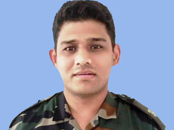 Mortal remains of Major Chitresh Singh Bisht brought to his residence in Dehradun