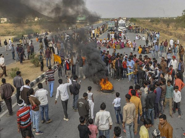 Gujjar community members block national highway 58 in support of their demand for reservation in Ajmer, Sunday, Feb 10, 2019. (PTI Photo)
