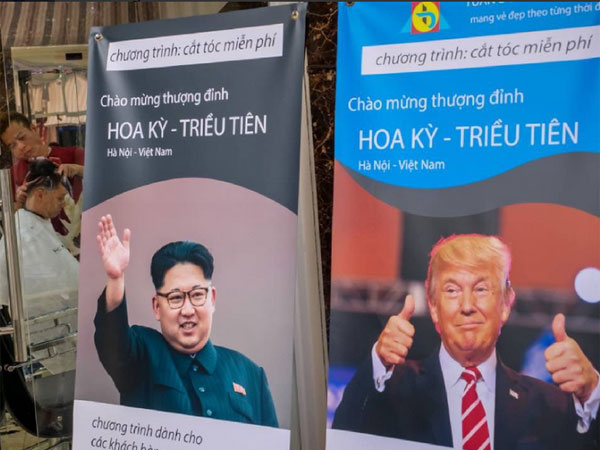 Le Tuan Duong gives Trump and Kim haircuts to people in his saloon in Hanoi; credit image: Twitter handle @bancha333