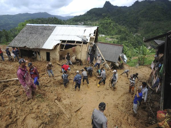 File photo of rescuers searching for victims at a village hit by a landslide in Sirnaresmi, Indonesia on Jan. 1, 2019 (Image-PTI)