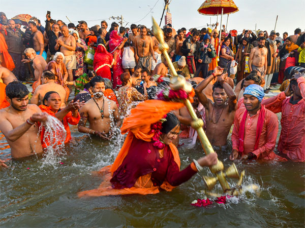 Devotees take a holy dip at Sangam during Makar Sankranti
