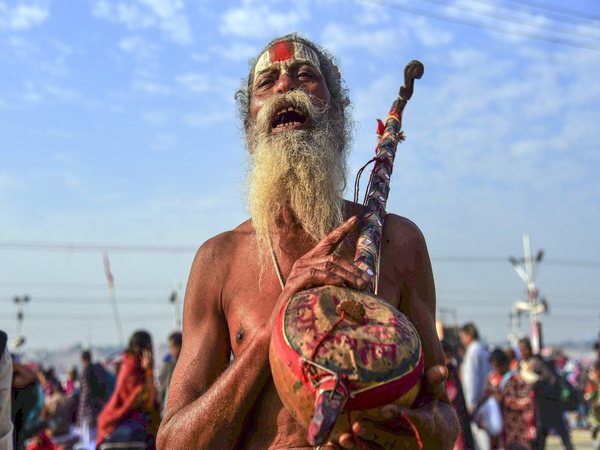 A sadhu chants hymns after taking a holy dip at Sangam