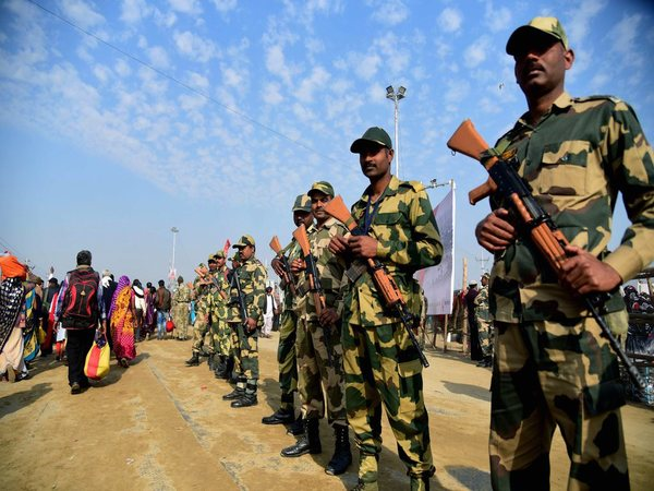 Paramilitary forces stand guard at Sangam on the auspicious 'Maghi Purnima' day