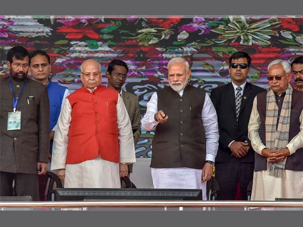 Prime Minister Narendra Modi flanked by Bihar Governor Lalji Tandon and Chief Minister Nitish Kumar during the inauguration and foundation stone-laying ceremony of various development projects, in Begusarai, Sunday, Feb 17, 2019. Also seen is Union Minister Ram Vilas Paswan.