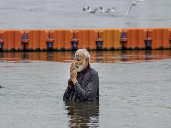 PM Modi takes holy dip, offers prayers at Kumbh in Prayagraj
