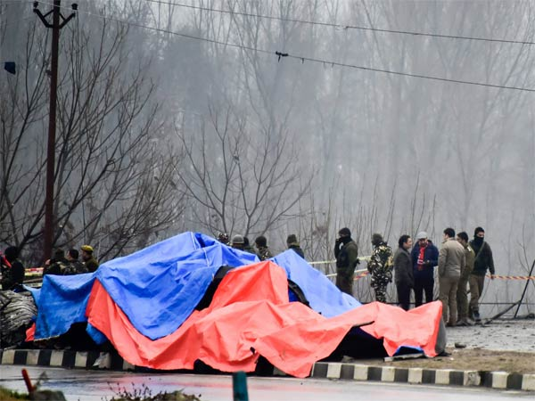Security agencies inspect the site of suicide bomb attack at Lethpora area, in Pulwama district of south Kashmir