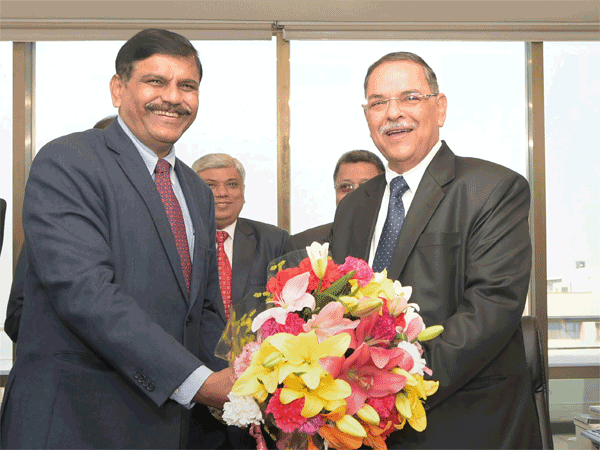 Interim Central Bureau of Investigation (CBI) chief M Nageswara Rao presents a bouquet to the newly-appointed CBI Chief Rishi Kumar Shukla as he takes charge at CBI headquarters, in New Delhi