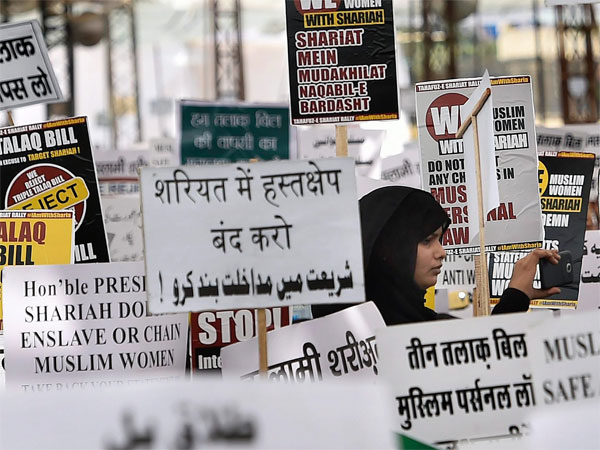 Muslim women display placards during a protest against triple talaq bill in New Delhi. PTI file photo