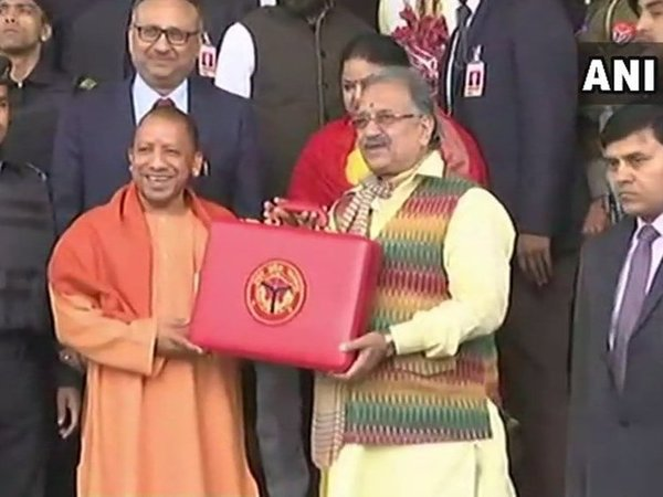 Uttar Pradesh Chief Minister Yogi Adityanath and Finance Minister Rajesh Agarwal with the budget briefcase. Courtesy: ANI news