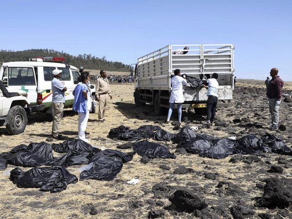 Rescuers remove body bags from the scene of an Ethiopian Airlines flight that crashed shortly after takeoff at Hejere near Bishoftu, or Debre Zeit, some 50 kilometers (31 miles) south of Addis Ababa, in Ethiopia Sunday, March 10, 2019. PTI file photo