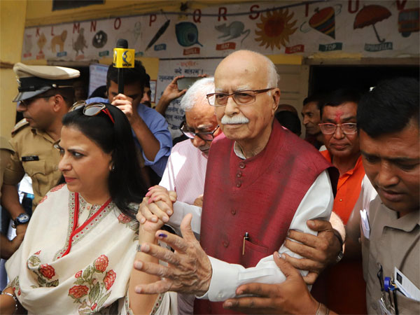 BJP veteran L K Advani leaves along with his daughter Pratibha after casting his vote at a polling station, during the third phase of Lok Sabha elections 2019, in Ahmedabad