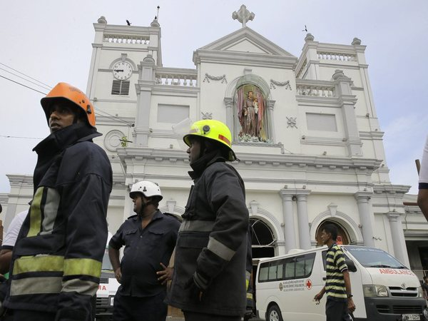 Sri Lankan firefighters stand in the area around St. Anthonys Shrine after a blast in Colombo, Sri Lanka, Sunday. PTI photo
