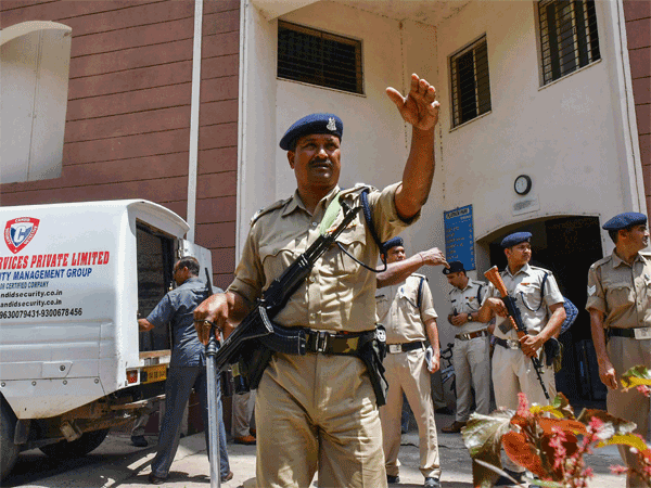 CRPF jawans guard as Income Tax officials recover cash after raids at the premises of lobbyist Ashwini Sharma, in Bhopal