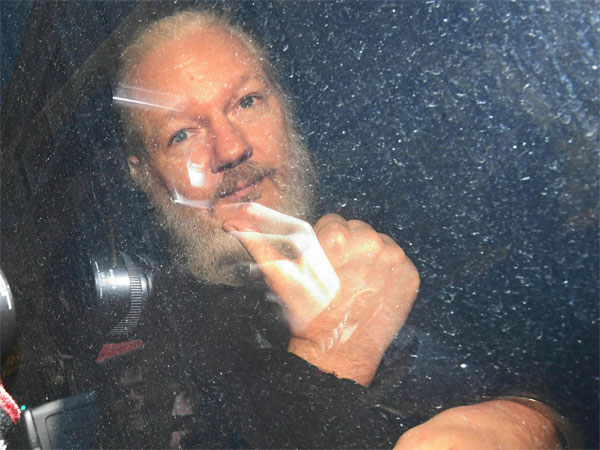 Julian Assange gestures as he arrives at Westminster Magistrates Court in London, after the WikiLeaks founder was arrested by officers from the Metropolitan Police and taken into custody Thursday April 11, 2019. PTI photo